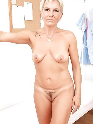 Fuckable mature blonde with hairy cunt undressing in the gyno office