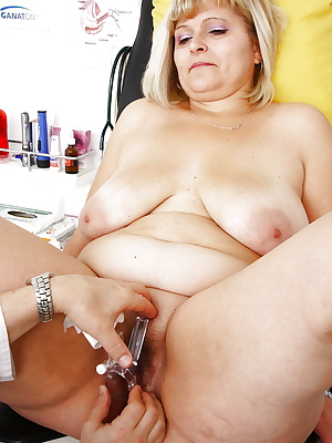 Mature fatty with hairy pussy receiving enema from gyno doctor