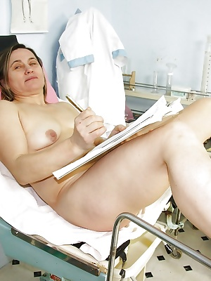 Mature at the gyno gets her hairy twat spread wide & finger violated