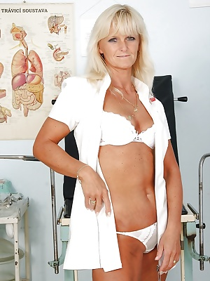 Naughty mature nurse taking off her lingerie and exposing her cunt