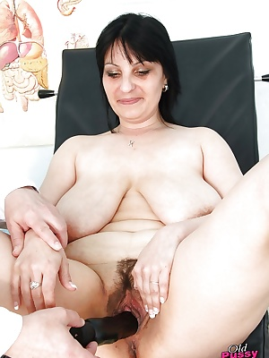 Old woman gets her nasty hairy pussy stretched and examined