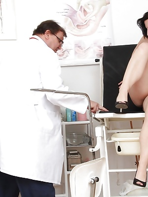Mature lady Lydie spreading legs for doctor to insert speculum