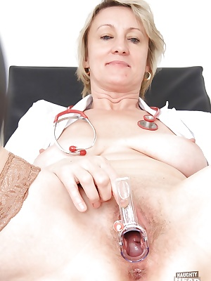 Mature slut with hairy pussy Ester takes part in a gyno scene
