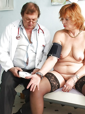 Redhead mature lady in stockings toying her twat after gyno exams