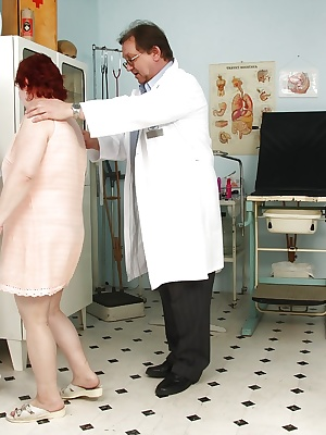 Fatty redhead mature lady with big tits gets her twat examed by gyno