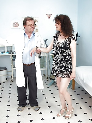 Mature brunette gets her hairy twat examed and toyed by gyno