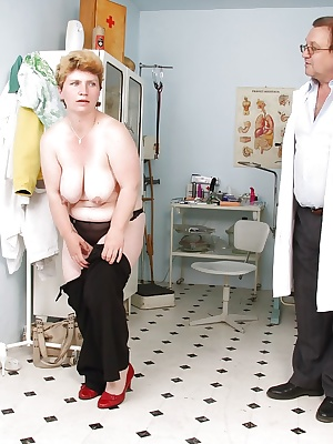 Chubby mature lady with big tits toying her cunt in gyno room