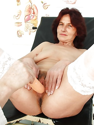 Mature brunette with flabby tits gets her shaggy cunt examed by gyno