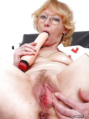 Sensuous mature nurse in glasses masturbating her cunt with various toys