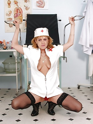 Naughty redhead mature nurse on high heels toying her shaved twat