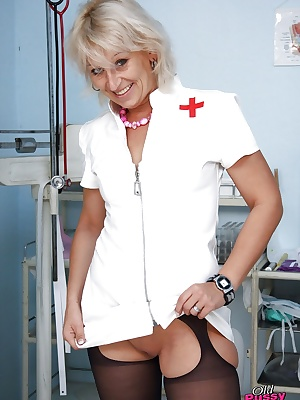 Filthy mature gyno nurse with shaved cunt has no lingerie under her uniform