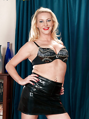 Blond fatty in latex skirt and sheer panties spreading her cunt and masturbating