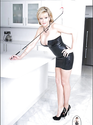 Big busted lady in low neck latex dress revealing her inviting cunt