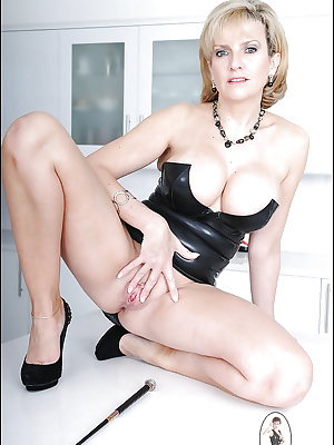 Hot matuer babe in black latex dress doing upskirt and teasing her cunt
