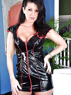 Raquel Devine slipping off her latex outfit and slipping on a strapon