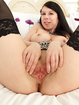 Naughty British housewife playing with her wet pussy