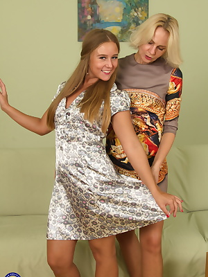 Hot old and young lesbian couple go at it on the couch