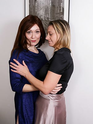 Two British lesbian housewives fooling around with eachother