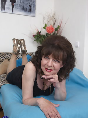 Hairy mature lady playing with her toy boy