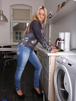 Naughty German mom playing in her kitchen with her cucumber