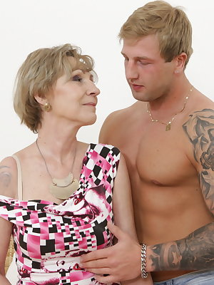 Horny mature lady fooling around with a muscular toy boy