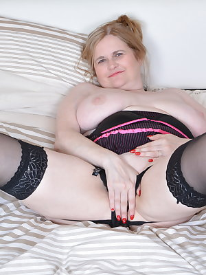 This big breasted mature lady loves to play alone