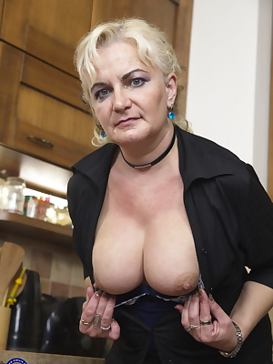 Horny housewife playing with her wet pussy in her kitchen