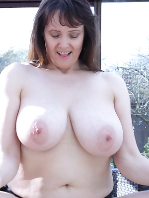 Big breasted British housewife getting wet
