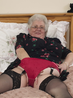 British granny playing with her voluptous body