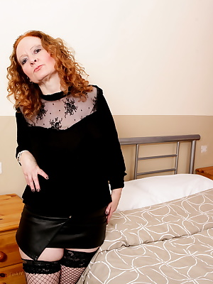 Naughty red mature lady from the UK having a ball