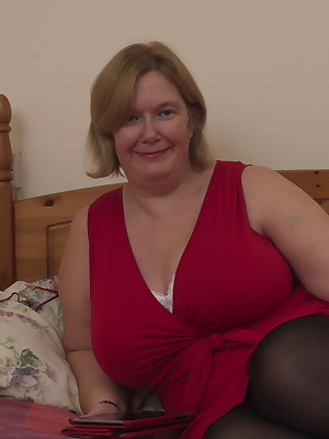 Large British mature lady with big natural tits getting dirty