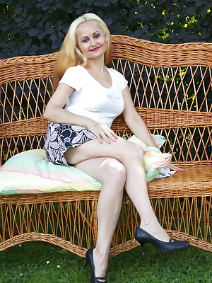 Blonde european housewife playing in the garden