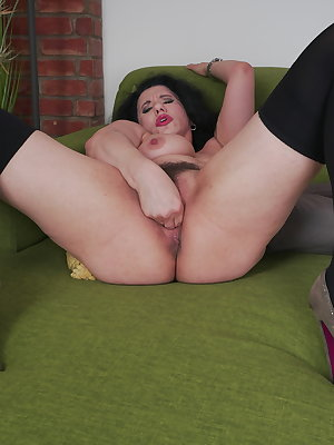 Horny hairy housewife playing with her pussy