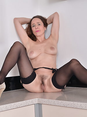 Hairy British housewife getting wet and wild