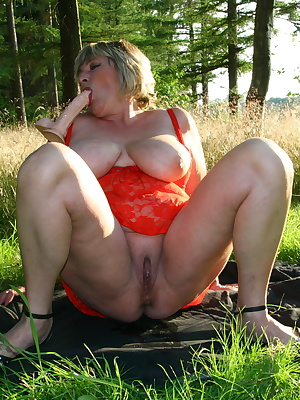 Big breasted mature Monieka gets naughty outside