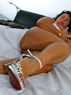 Big breasted mature slut playing with her toy