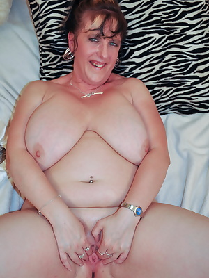 Huge breasted mature slut getting wet