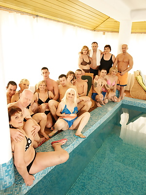 Six mature sluts get fucked by six dudes at the pool