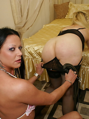 Two lesbians with different ages playing and licking